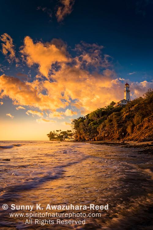 Sunset at Diamond Head Lighthouse and Diamond Head Beach Park. Honolulu, Oahu Island, Hawaii.