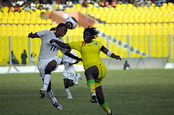 Black Queen's Patience Kpobi (L) and Senegalese Many Ndiaye jump for the ball in a qualifying match  against the Senegalese senior female team, Teranga Lionesses, who the Queens beat 3-0 to claim one of the seven places available for the African Women's Championship (AWC) to be hosted by South Africa in September, 2010. (Credit: Emmanuel Quaye/Twenty Ten/Africa Media Online)
