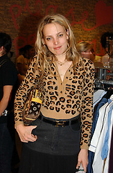 BAY GARNETT at a Topshop hosted Jumbo Thrift Sale - a sale of designer fashion, in association with the Terence Higgins Trust for World Aids Day, held at Topshop, Oxford Circus, London on 1st December 2004.<br /><br />NON EXCLUSIVE - WORLD RIGHTS