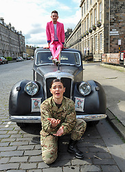Pictured: Performer Nick Alban, from show the Happiness Prohect poses on the roof of a vintage car, along with opera singer Lila Palmer , from the show Dead Equal.<br /> <br /> The Army at the Fringe venue opened it's doors today, with five shows on. <br /> <br /> © Dave Johnston / EEm