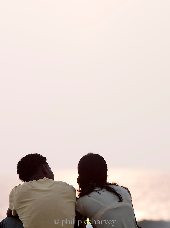 A local couple watching the sunset in Galle, Sri Lanka