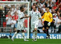 Photo: Tom Dulat.<br /> England v Estonia. UEFA European Championships Qualifying. 13/10/2007.<br /> Wayne Rooney(R) celebrates his goal together with Ashley Cole(L), England leads 2-0