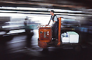 A motion image of a motorized cart used to transport fish as it is bought and sold at  Tsukiji Wholesale fish market n Tokyo, Japan. April 14th 2006