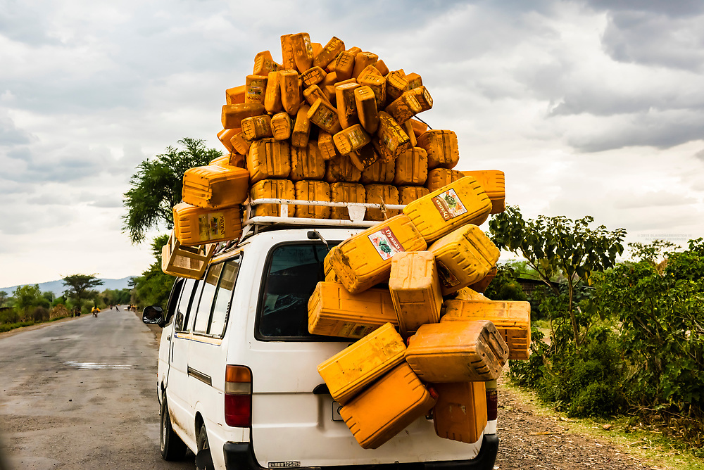 A minivan covered with water containers, Southern Nations Nationalities and People's Region, Ethiopia. The climate is arid and water is scarce in this part of Ethiopia, so much effort is spent to find and bring back water to villages in these containers.