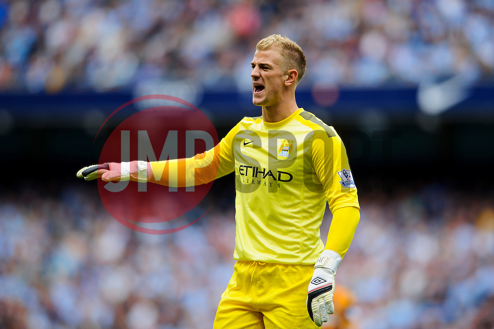 Man City Goalkeeper Joe Hart shouts at his defence during the second half of the match - Photo mandatory by-line: Rogan Thomson/JMP - Tel: Mobile: 07966 386802 31/08/2013 - SPORT - FOOTBALL - Etihad Stadium, Manchester - Manchester City v Hull City Tigers - Barclays Premier League.