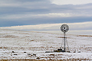 water pump  in the in the snow on a cattle ranch in Wyoming WY USA
