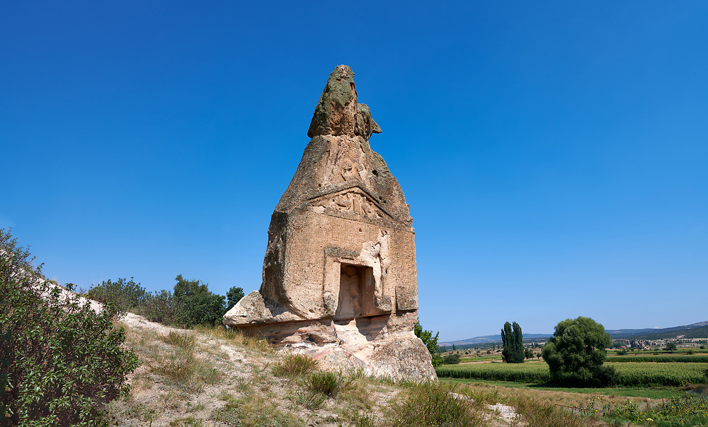 Phrygian temple of Aslankaya, 7th century BC. Phyrigian Valley, Emre Lake, near Doger, Turkey.<br /> <br /> On the triangular roof over the facade are two sphinxes (winged figures with the head of a human and the body of a lion), facing one another, take place. In the main facade, below, the sphinxes in a niche, a cult statue of Kybele or the Great Mother (vandalised and destroyed) was flanked by two lions. This main facade is ornamented with relief geometrical patterns. .<br /> <br /> If you prefer to buy from our ALAMY PHOTO LIBRARY  Collection visit : https://www.alamy.com/portfolio/paul-williams-funkystock/aslankaya-temple-turkey.html<br /> <br /> Visit our TURKEY PHOTO COLLECTIONS for more photos to download or buy as wall art prints https://funkystock.photoshelter.com/gallery-collection/3f-Pictures-of-Turkey-Turkey-Photos-Images-Fotos/C0000U.hJWkZxAbg
