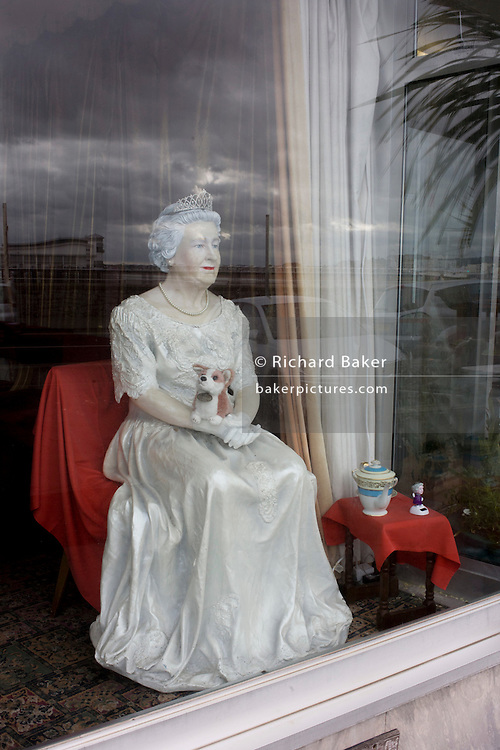 A mannequin of Queen Elizabeth appears in a hotel window on the seafront of Weston-super-Mare, north Somerset.