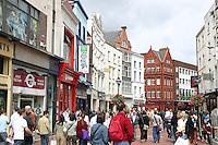 Shoppers on a busy Grafton Street Dublin Ireland