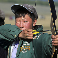 """MONGOLIA, Archer at a """"Naadum"""" festival in Rinchenlhumbe, Darhad Valley. This is one  the nation's most popular sports."""