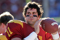 3 December 2005: Senior quarterback #11 Matt Leinart played his last college football game at the Coliseum during a USC 66 win over UCLA 19 College Football Pac-10 rivilary showdown at the Los Angeles Memorial Coliseum, CA. Leinart keeps  his arm loose on the sidelines, taking a deep breath after having a difficult first quarter with a 0-for-5 start.