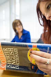 A student using a dictionary on a basics skills course
