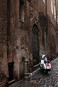 Motorcycle parked on a wet street, Rome, Italy