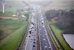 © Licensed to London News Pictures. 14/04/2017. Huddersfield UK. Picture shows heavy traffic on the M62 near Huddersfield in Yorkshire as people make their getaway for the easter weekend. Photo credit: Andrew McCaren/LNP