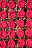 Rice is dyed pink for a festival and formed into cakes, Bali, Indonesia, Southeast Asia