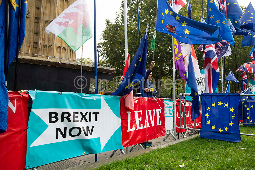 Pro-EU and leave banners outside the Houses of Parliament on 23rd October, 2019 in London, England, United Kingdom. The government await news from the EU granting another Brexit extension. Last night Prime Minister Boris Johnson 'paused' discussions on his EU withdrawal bill after MPs voted against the government rushing it through in three days, Speaker John Bercow described the bill as bill now being in limbo.