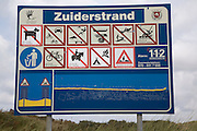 Sign with beach rules Zuiderstrand near Scheveningen Holland