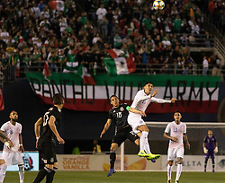 March 22, 2019 - Andres Guardado (18) of Mexico and Pablo Hernandez (16) of Chile attempt to headbutt the ball during Mexico's 3-1 victory over Chile. (Credit Image: © Rishi Deka/ZUMA Wire)