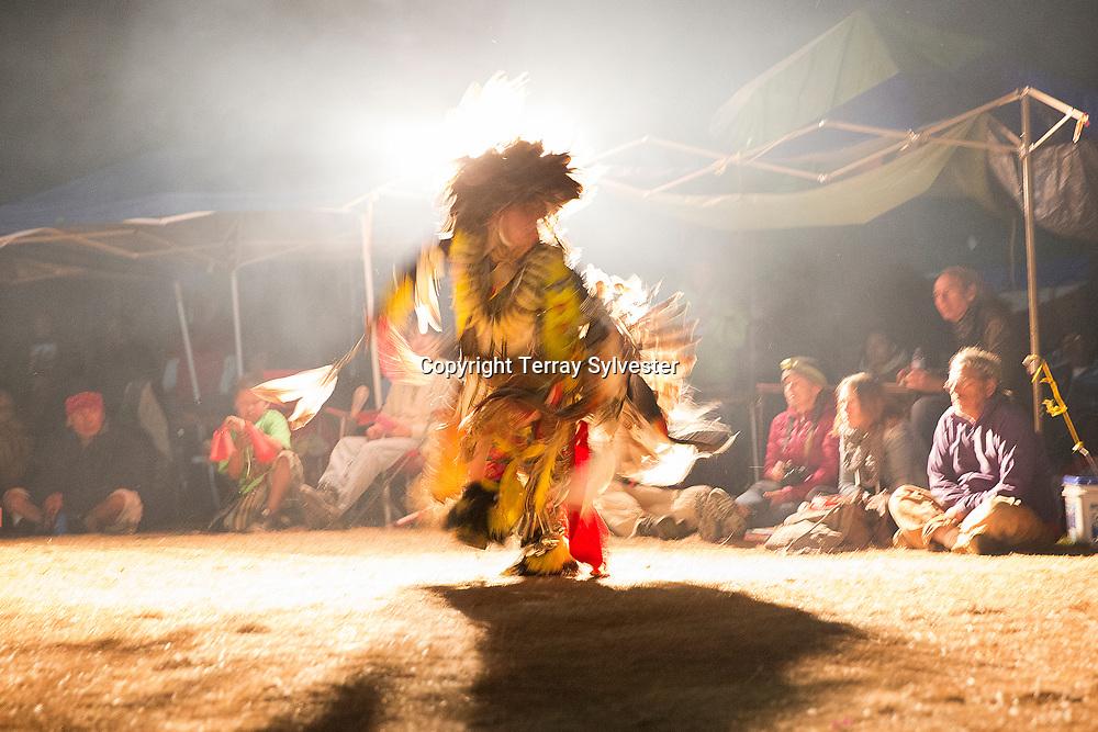 An Oglala Lakota fancy dancer performs in the opposition camp against the Dakota Access oil pipeline on September 18, 2016. Cannon Ball, North Dakota, United States.
