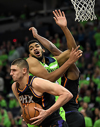 December 16, 2017 - Minneapolis, MN, USA - The Phoenix Suns' Alex Len (21) pulls down a rebound off a missed shot by the Minnesota Timberwolves' Karl-Anthony Towns in the fourth quarter on Saturday, Dec. 16, 2017, at Target Center in Minneapolis. The Suns won, 108-106. (Credit Image: © Aaron Lavinsky/TNS via ZUMA Wire)