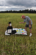"""Humorous photograph of a man and a mime in a field with the man not wanting to play games with the mime visually depicting the saying """"Mime (mind) games!"""""""