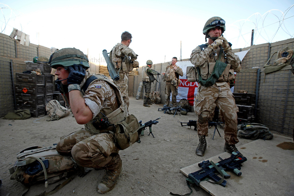"""Mcc0018106 . SundayTelegraph..For the Sunday Telegraph..Soldiers from Arnhem Coy , 2 Lancs at a patrol base in the Nad e'Ali district of Helmand province, southern Afghanistan. A section patrolled from the base and was fired upon in a """"contact""""  by the Taliban and a QRF (quick reaction force) came to assist in their safe extraction...Afghanistan 10 November 09"""