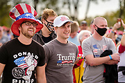 14 OCTOBER 2020 - DES MOINES, IOWA: People in line to get into a campaign rally for President Donald Trump. About10,000 people were expected at the Des Moines International Airport for a campaign rally supporting the reelection of President Trump. Trump spoke at the rally, despite testing positive for COVID-19 less than three weeks ago. The rally did not meet the CDC guidelines for a safe gathering in the time of Coronavirus and violated Iowa's health emergency declarations barring gatherings of more than 25 people. This week Iowa exceeded 101,000 cases of COVID-19 and a surge in hospitalizations for COVID-19.      PHOTO BY JACK KURTZ