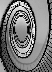 The uniquely surreal spiral stair case viewed from the ground floor of the newly renovated Hotel Amigo in the center of Brussels. (Photo © Jock Fistick)