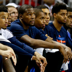 Dec 2, 2014; New Orleans, LA, USA; Oklahoma City Thunder forward Kevin Durant (center) with teammates on the bench during the second half of a game against the New Orleans Pelicans at the Smoothie King Center. The Pelicans defeated the Thunder 112-104. Mandatory Credit: Derick E. Hingle-USA TODAY Sports