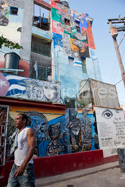 Callejon de Hamel, a street art project in old Havana, which has a Rumba show on a Sunday afternoon, and has strong links to the Santeria religion / cult. The work is made by local Cuban artist Salvador Gonzales Escalona.