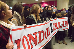"St Pancras, London, January 16th 2016. Dozens of protesters hold an ""emergency demonstration and die-in"" as France prepares to bulldoze the Jungle Camp at Calais. PICTURED: Protesters hold their London 2 Calais banner inside the King's Cross St Pancras tube station after finding their way into the Eurostar terminal blocked by police. ///FOR LICENCING CONTACT: paul@pauldaveycreative.co.uk TEL:+44 (0) 7966 016 296 or +44 (0) 20 8969 6875. ©2016 Paul R Davey. All rights reserved."