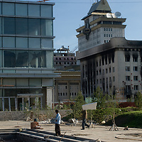 Workers begin reconstuction of a damaged building next to the charred Mongolian Peoples Revolutionary Party headquarters, which angry demonstrators set fire to protest what they believed to be a rigged national election in July, 2008.