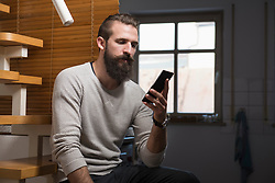 Young man messaging on cell phone