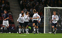 Photo: Andrew Unwin.<br /> Scotland v USA. International Challenge. 12/11/2005.<br /> The USA celebrate an early goal, scored by Joshua Wolff (#16) from the penalty spot.