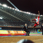 A panoramic view of a long jumper in action in the men's long jump final at Olympic Stadium at the Athens 2004 Olympic Games in Athens, Greece, August 26, 2004. Photo Tim Clayton