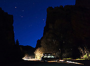 A parked car at night in a parking area at Eldorado Canyon State Park, Colorado.