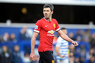 Michael Carrick of Manchester United looks on. Barclays Premier league match, Queens Park Rangers v Manchester Utd at Loftus Road in London on Saturday 17th Jan 2015. pic by John Patrick Fletcher, Andrew Orchard sports photography.