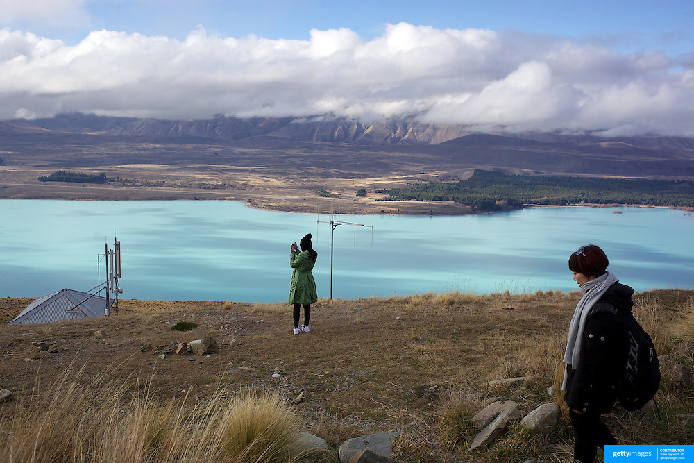 The view from the top of Mount John overlooking Lake Tekapo and Mackenzie Country, South Island, New Zealand. Mount John is also the home of the Mount John University Observatory, Lake Tekapo has one of the most spectacular night skies in the world and is a popular tourist destination. 8th June 2011.