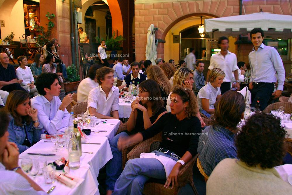 ITALY, Liguria, S. Margherita: bar ristorante Miami....ITALY, Liguria, S. Margherita: young adolescent in pretty nice restaurant