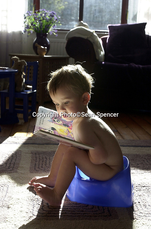 A young boy reads a book while sitting on a potty.<br /> <br /> Picture:Sean Spencer/Hull News & Pictures 01482 210267/07976 433960<br /> <br /> High resolution picture library at http://www.hullnews.co.uk<br /> <br /> ©Sean Spencer/Hull News & Pictures Ltd<br /> <br /> NUJ recommended terms & conditions apply. Moral rights asserted under Copyright Designs & Patents Act 1988. Credit is required. No part of this photo to be stored, reproduced, manipulated or transmitted by any means without permission.