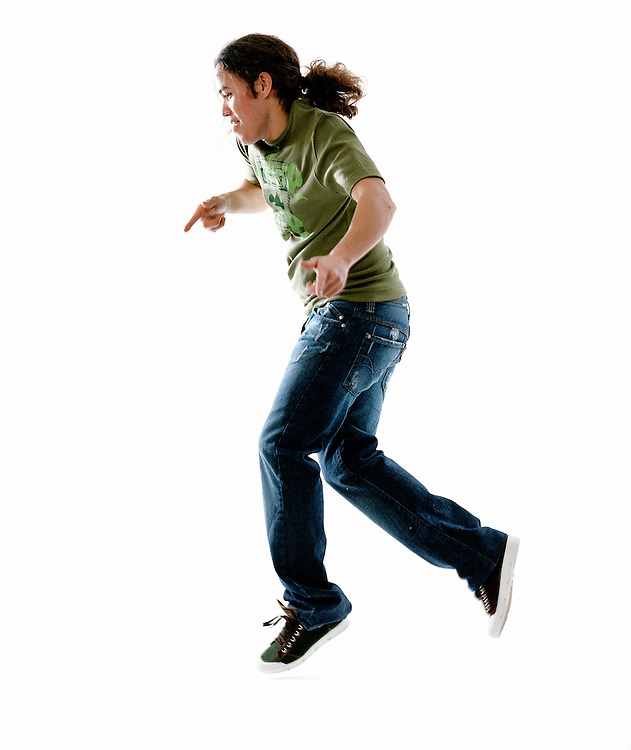 Man in green Tshirt and jeans dancing.