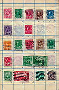 A collection of old stamps from Canada Philately is the study of postage stamps and postal history.
