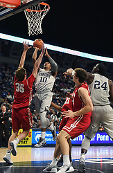 December 4, 2017 - University Park, PA, USA - Penn State guard Tony Carr jumps up toward the basket during a game against Wisconsin on Monday, Dec. 4, 2017 at the Bryce Jordan Center in University Park, Pa. (Credit Image: © Phoebe Sheehan/TNS via ZUMA Wire)