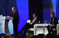 Russian President Vladimir Putin, French President Emmanuel Macron and John Micklethwait chief editor of Bloomberg News attending a session of the Saint Petersburg International Economic Forum on May 25, 2018 in Saint Petersburg.Photo by Christian Liewig/ABACAPRESS.COM