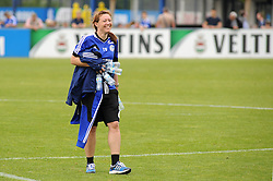24.04.2014, Veltins Arena, Gelsenkirchen, GER, 1. FBL, Training Schalke 04, im Bild Sportpsychologin Theresa Holst ( Schalke 04 ) traegt gut gelaunt leere Wasserflaschen von Trainingsplatz. // during a Trainingsession of German Bundesliga Club Schalke 04 at the Veltins Arena in Gelsenkirchen, Germany on 2014/04/24. EXPA Pictures © 2014, PhotoCredit: EXPA/ Eibner-Pressefoto/ Thienel<br /> <br /> *****ATTENTION - OUT of GER*****