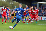 AFC Wimbledon midfielder Mitchell (Mitch) Pinnock (11) with a shot on goal during the EFL Sky Bet League 1 match between AFC Wimbledon and Scunthorpe United at the Cherry Red Records Stadium, Kingston, England on 15 September 2018.