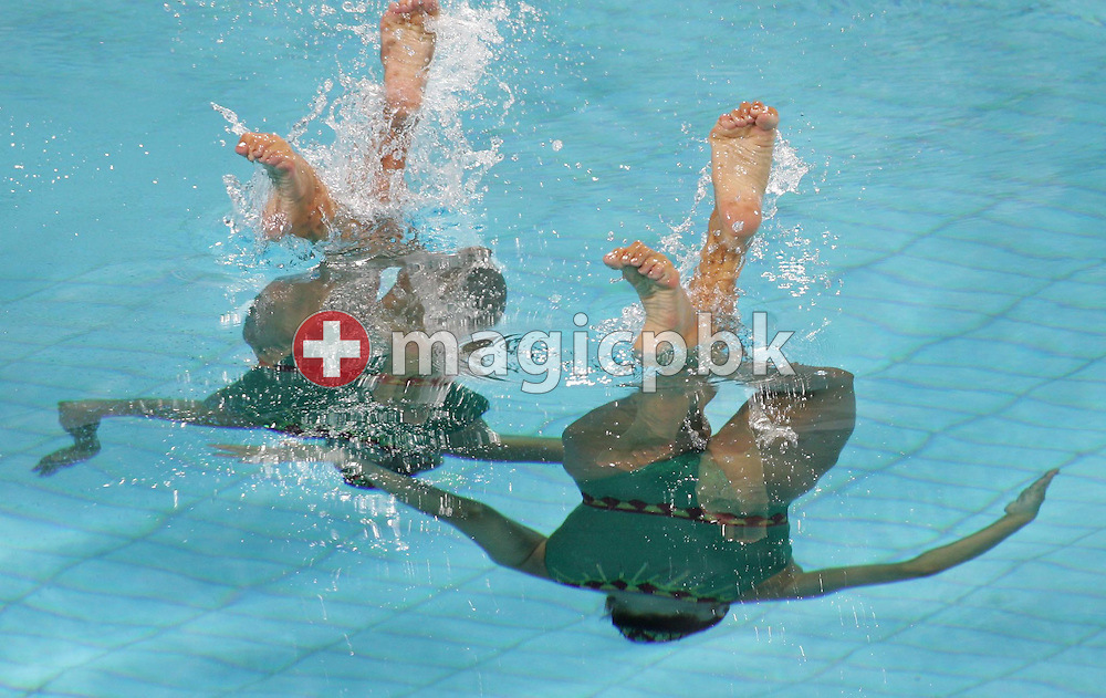 Ukrainian swimmers Iryna Gayvoronska and Darya Yushko participate in the Synchronised Swimming Pool Duet Technical Routine of the Athens 2004 Olympic Games at the Olympic Aquatic Centre in Athens Monday 23 August 2004.  ........ (Photo by Patrick B. Kraemer / MAGICPBK)