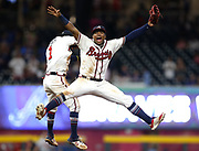 ATLANTA, GA - SEPTEMBER 14:  Left fielder Ronald Acuña, Jr. #13 (right) and second baseman Ozzie Albies #1 of the Atlanta Braves celebrate after the game against the Washington Nationals at SunTrust Park on September 14, 2018 in Atlanta, Georgia.  (Photo by Mike Zarrilli/Getty Images) *** Local Caption *** Ozzie Albies; Ronald Acuña; Jr.