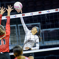 Tatum Coyote Maddy Rice (11), left, pressures Ramah Mustang Taleah Herron (6)  at the net during the New Mexico High School volleyball championship at the Santa Ana Star Center in Rio Rancho Friday.
