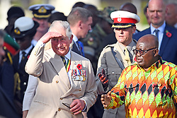 The Prince of Wales and President of Ghana, Nana Akufo-Addo, during the Commonwealth War Graves in Accra, Ghana, on day three of the royal couple's trip to west Africa.